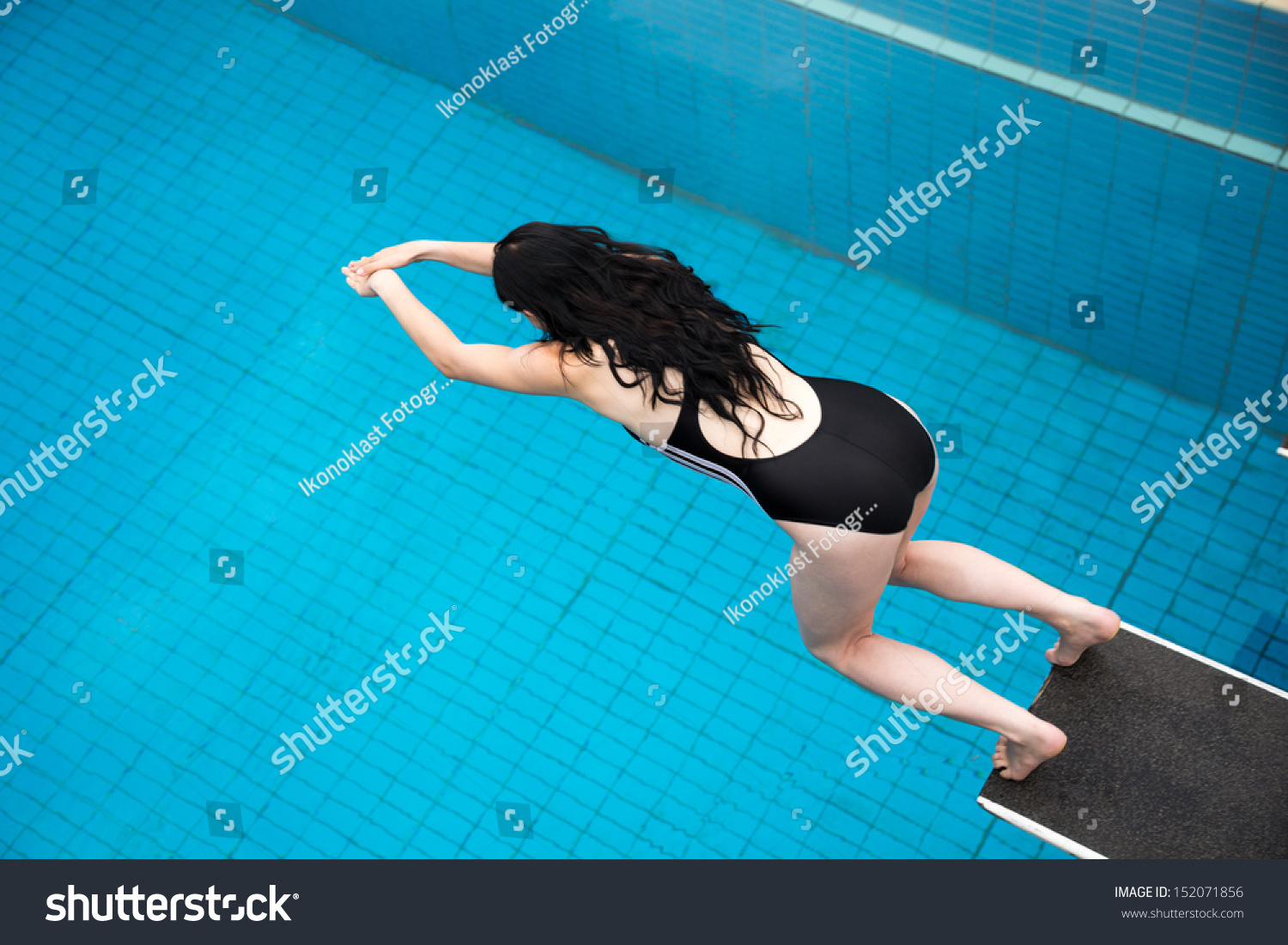 Public Swimming Pools With Diving Boards woman jumping diving board public swimming stock photo 152071856