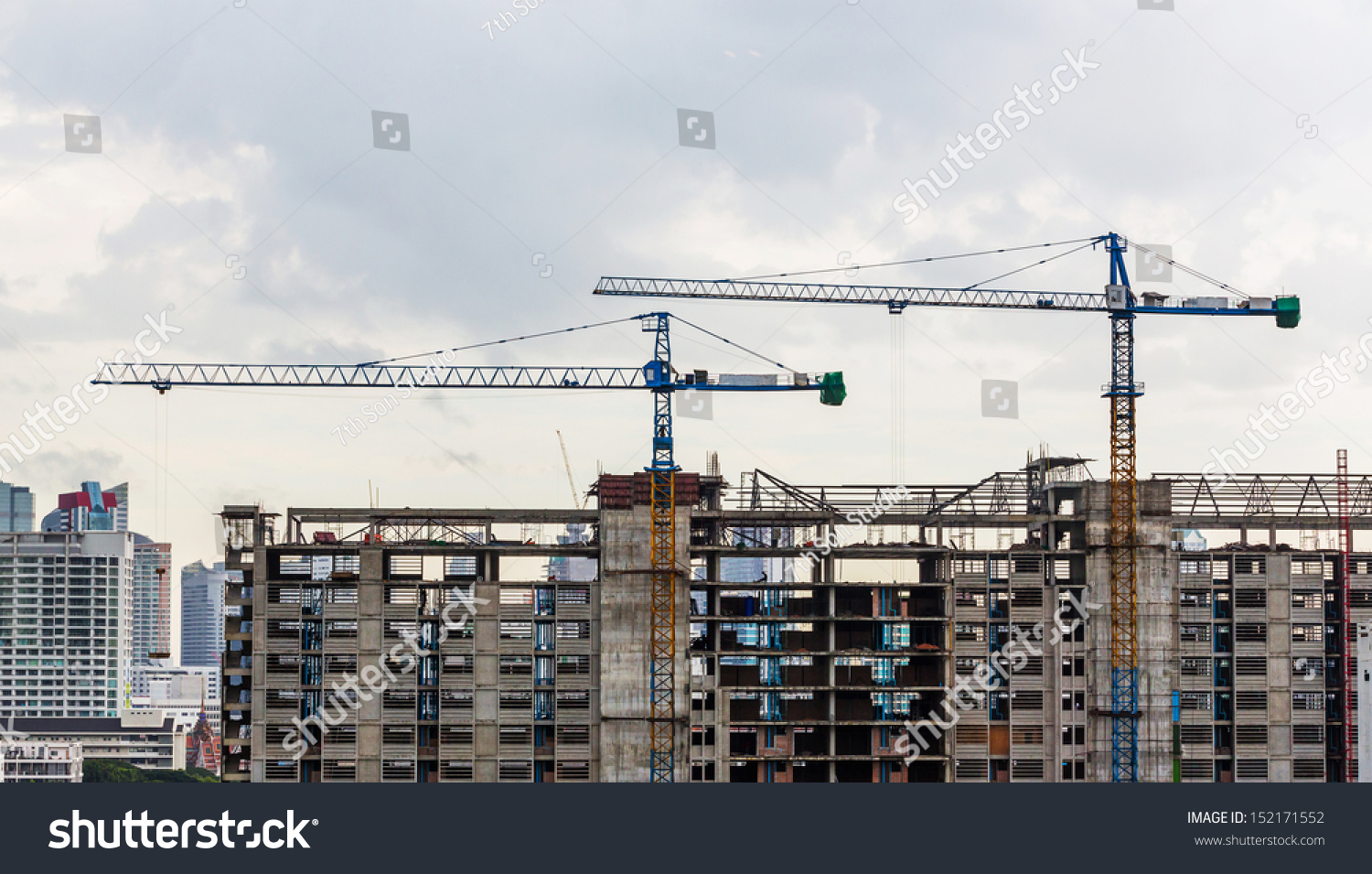 Construction crane on top building cloudy stock photo for Best builder construction