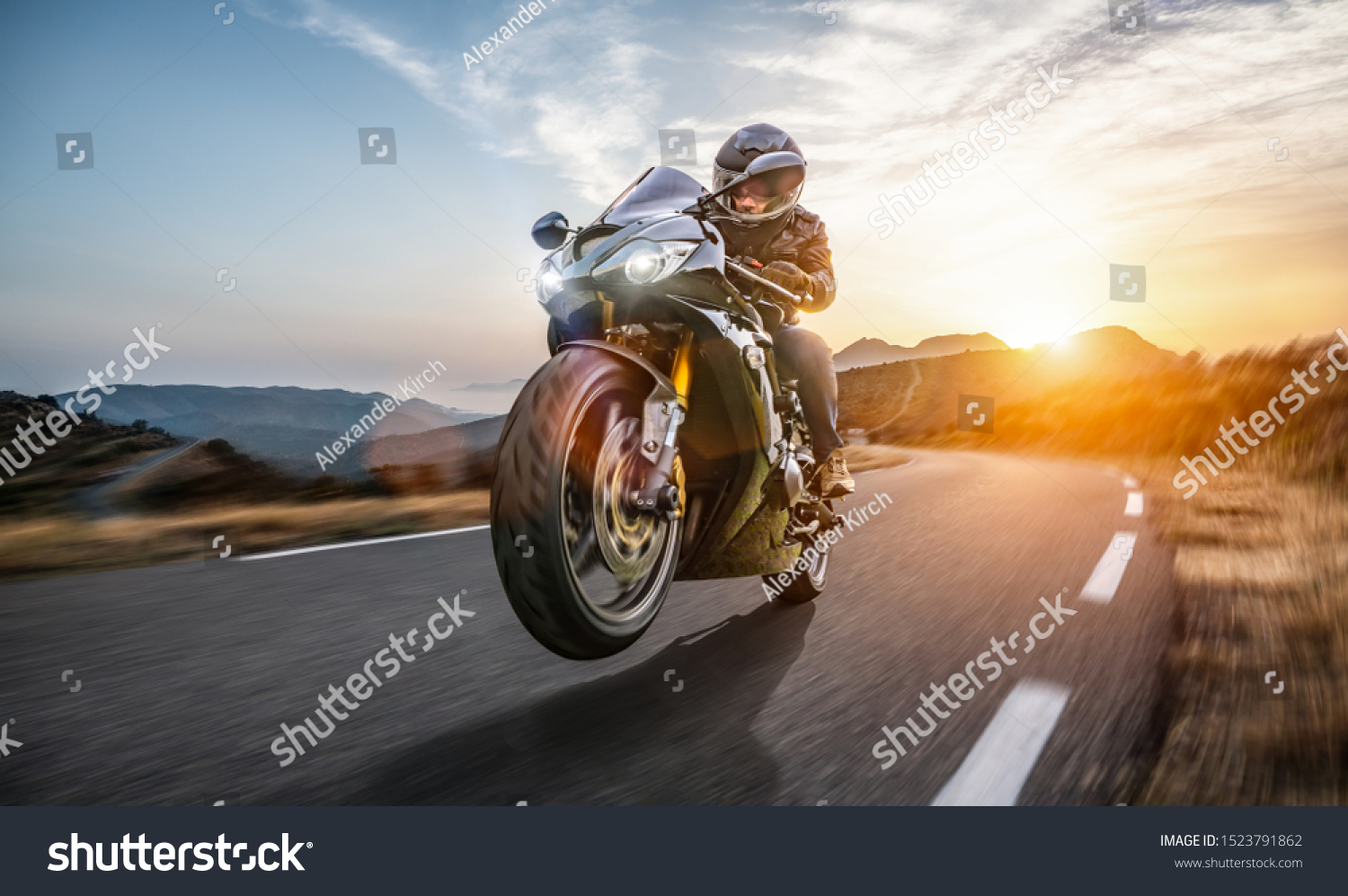 Fast Motorcycle on the coast road riding. having fun driving the empty highway on a motorbike tour journey. copyspace for your individual text. #1523791862