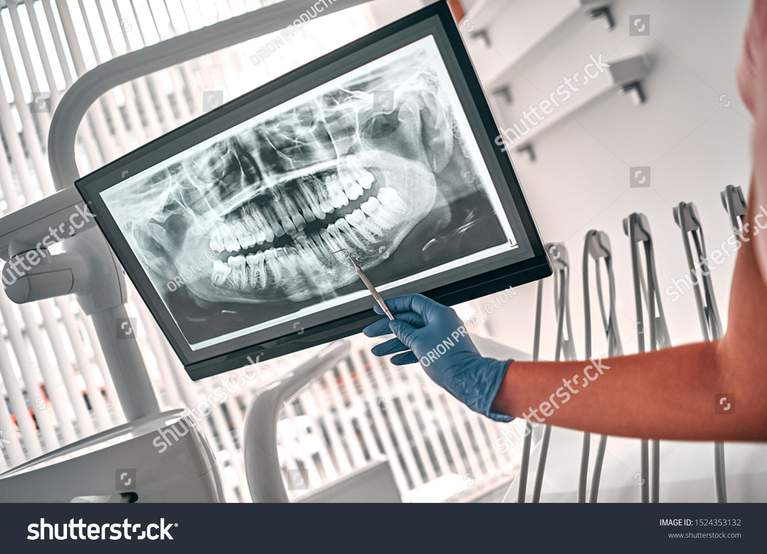 Image of doctor or dentist presenting with tooth x-ray film recommend patient in the treatment of dental and dentistry, working at workplace. #1524353132
