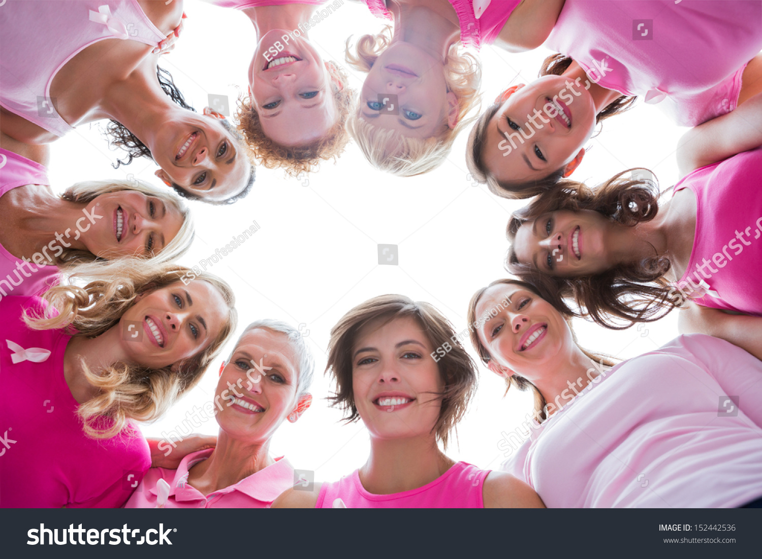 stock-photo-group-of-happy-women-in-circle-wearing-pink-for-breast-cancer-on-white-background-152442536.jpg