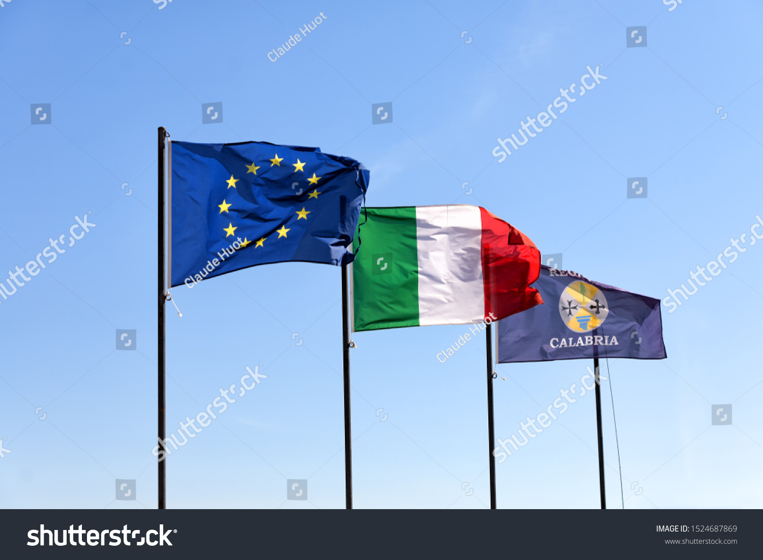 European Union, Italy and Calabria flags are flapping in the wind in the Calabrian region which is situated in the toe of the country's boot-shaped peninsula.