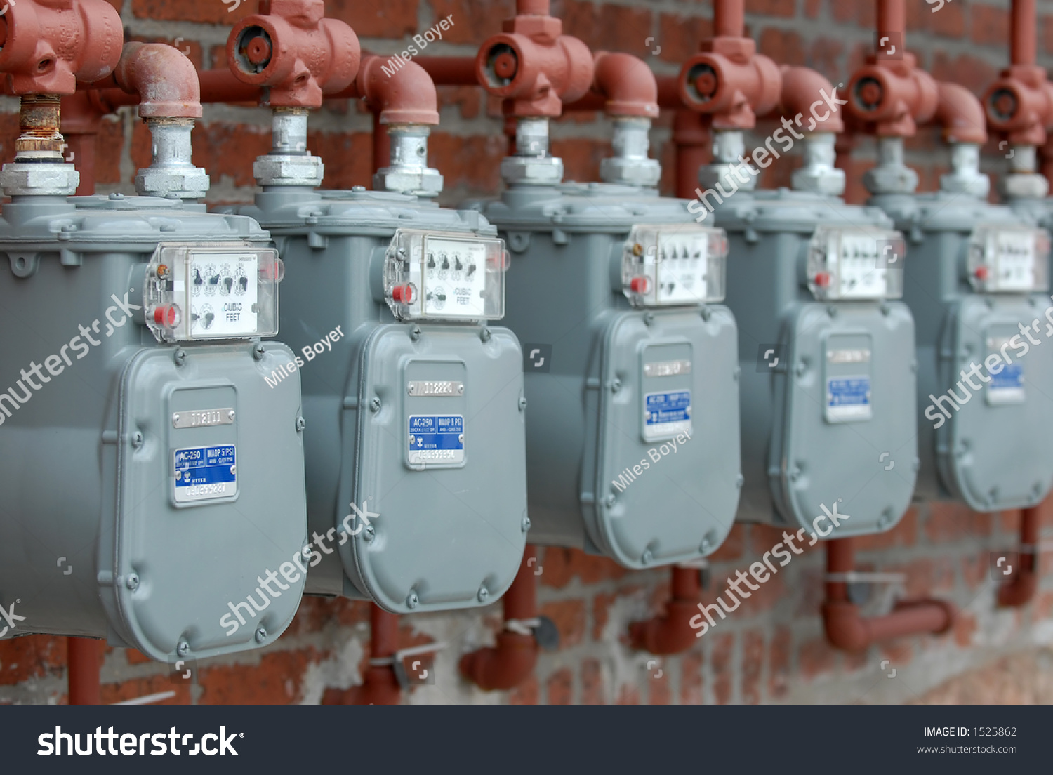 Home Gas Meter And Meter In Water : Row natural gas meters apartment complex stock photo