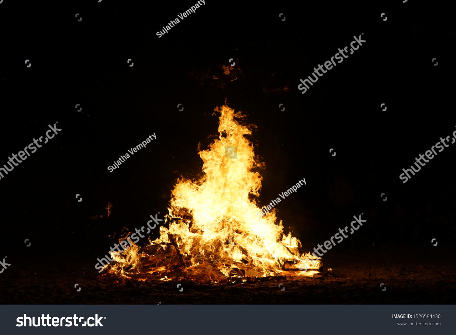 Bonfire of Burning Wood Pallets on a Beach #1526584436