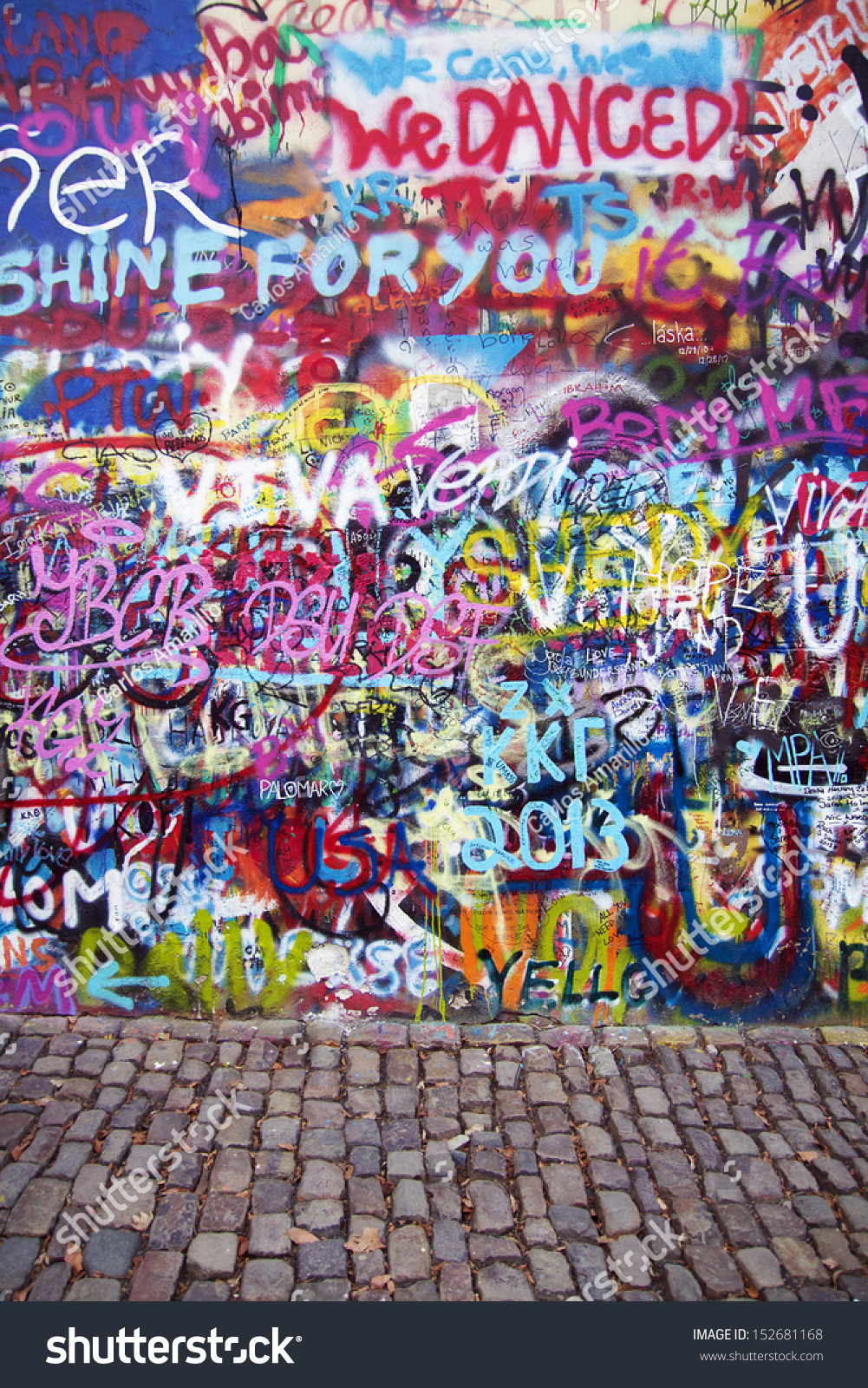 Prague czech republic april 12 the lennon wall since the 1980s is filled with john lennon inspired graffiti and pieces of lyrics from beatles songs on