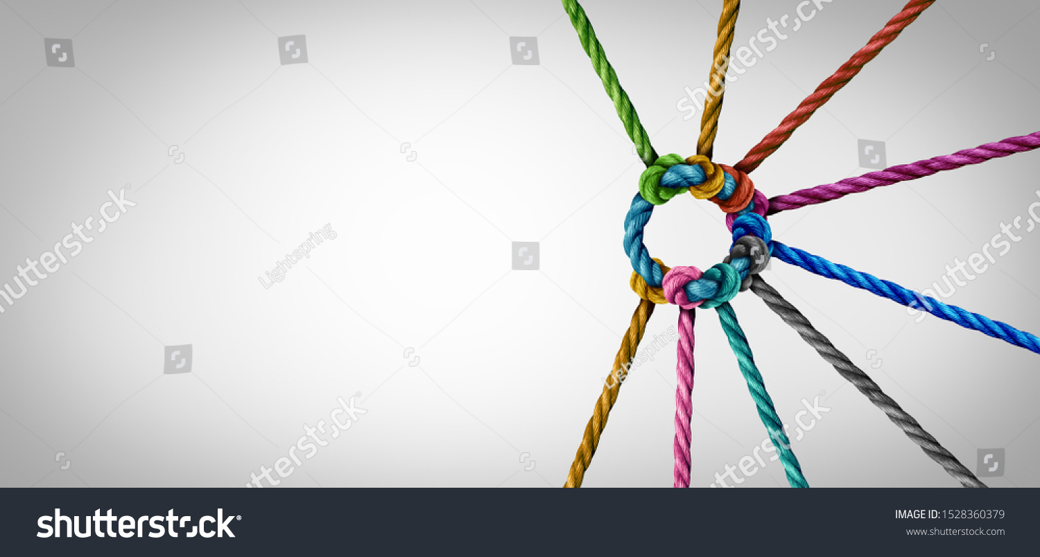 Unity and teamwork concept as a business metaphor for joining a partnership as diverse ropes connected together as a corporate symbol for cooperation and working collaboration. #1528360379