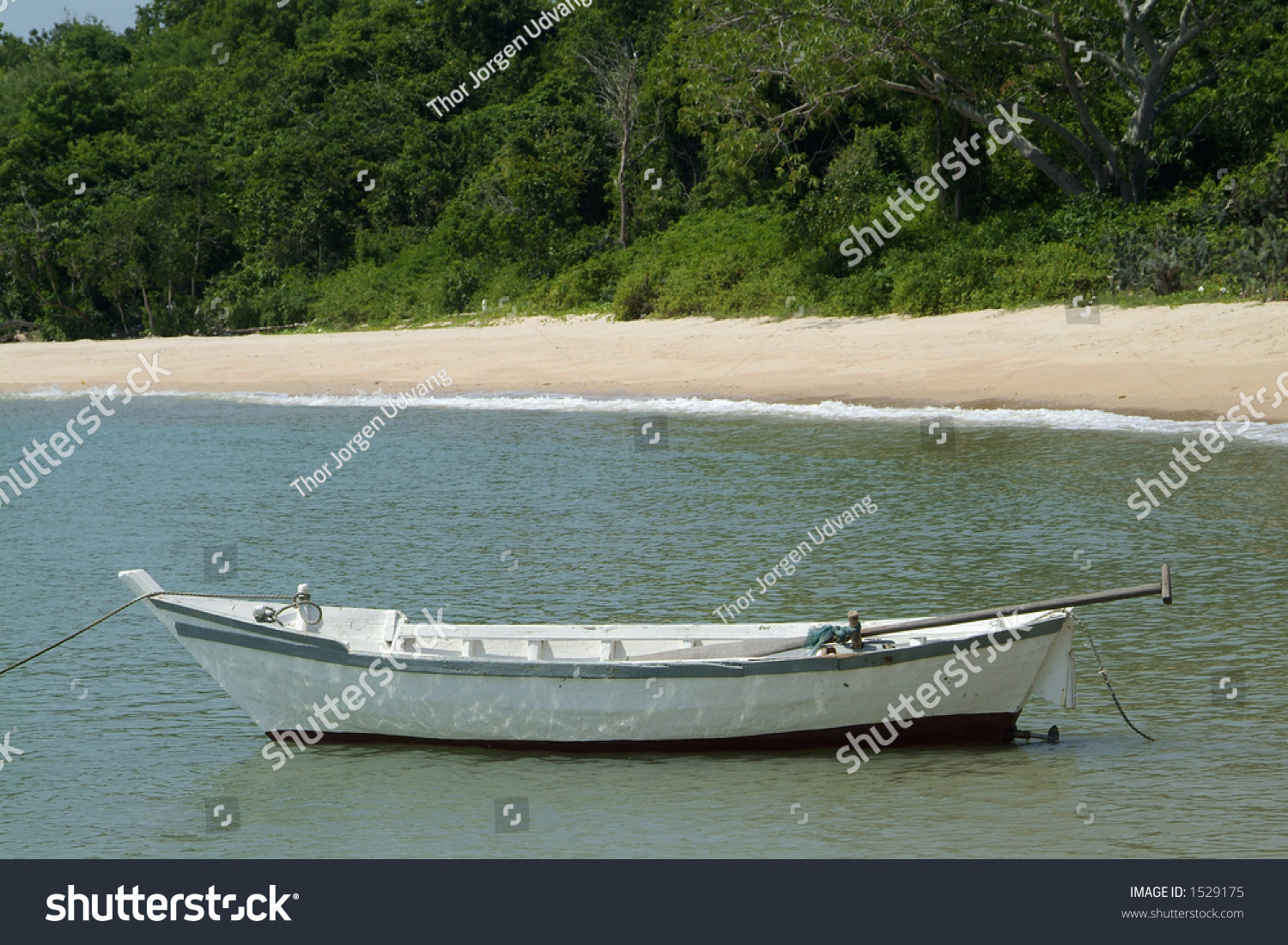 Small white wooden fishing boat near stock photo 1529175 for Boat fishing near me