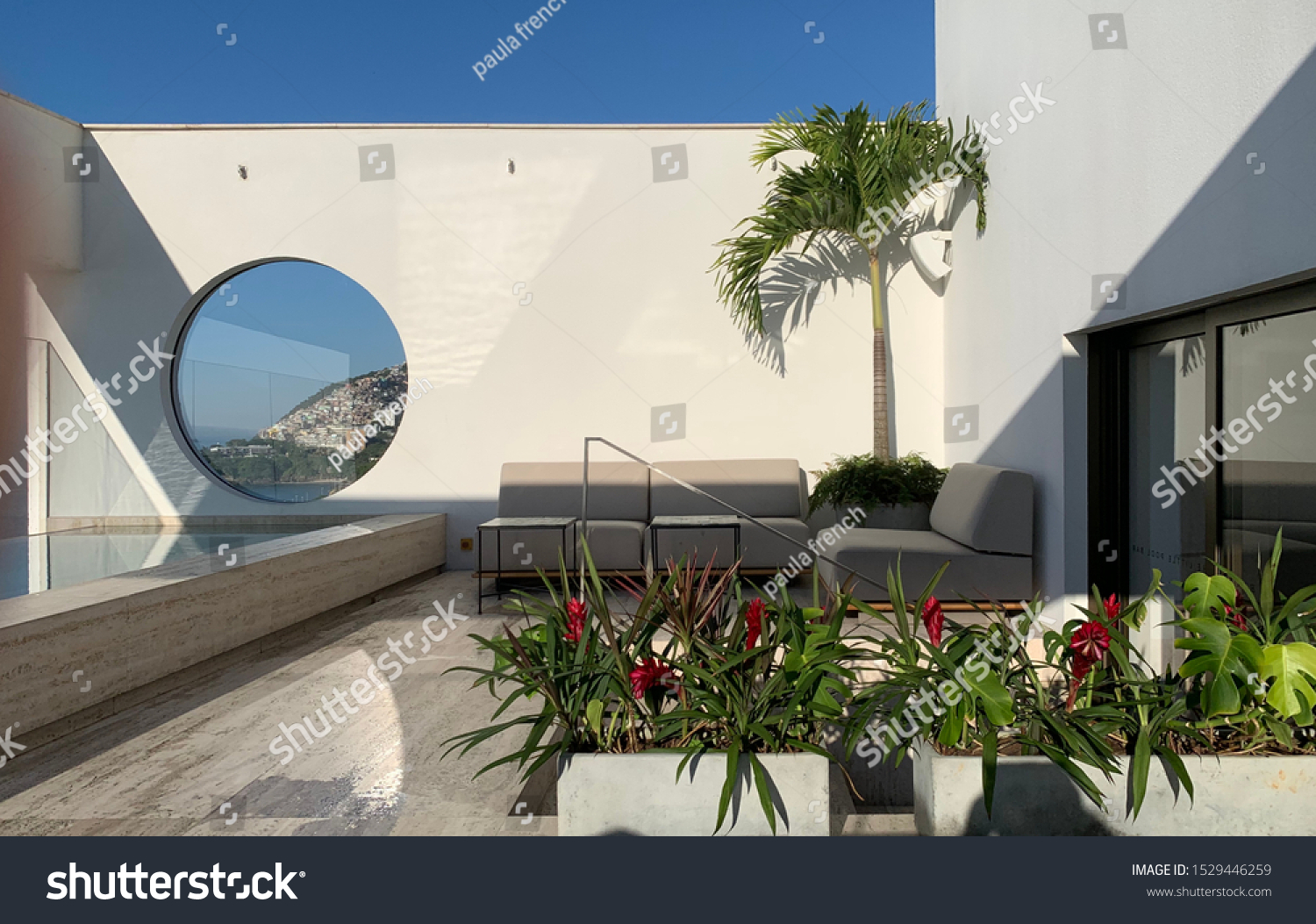 Janeiro Hotel, Rio, Brazil 2019 roof top terrace with infinity pool and view.. it is a luxury boutique hotel used by affluent travellers and is popular with a younger clientele.