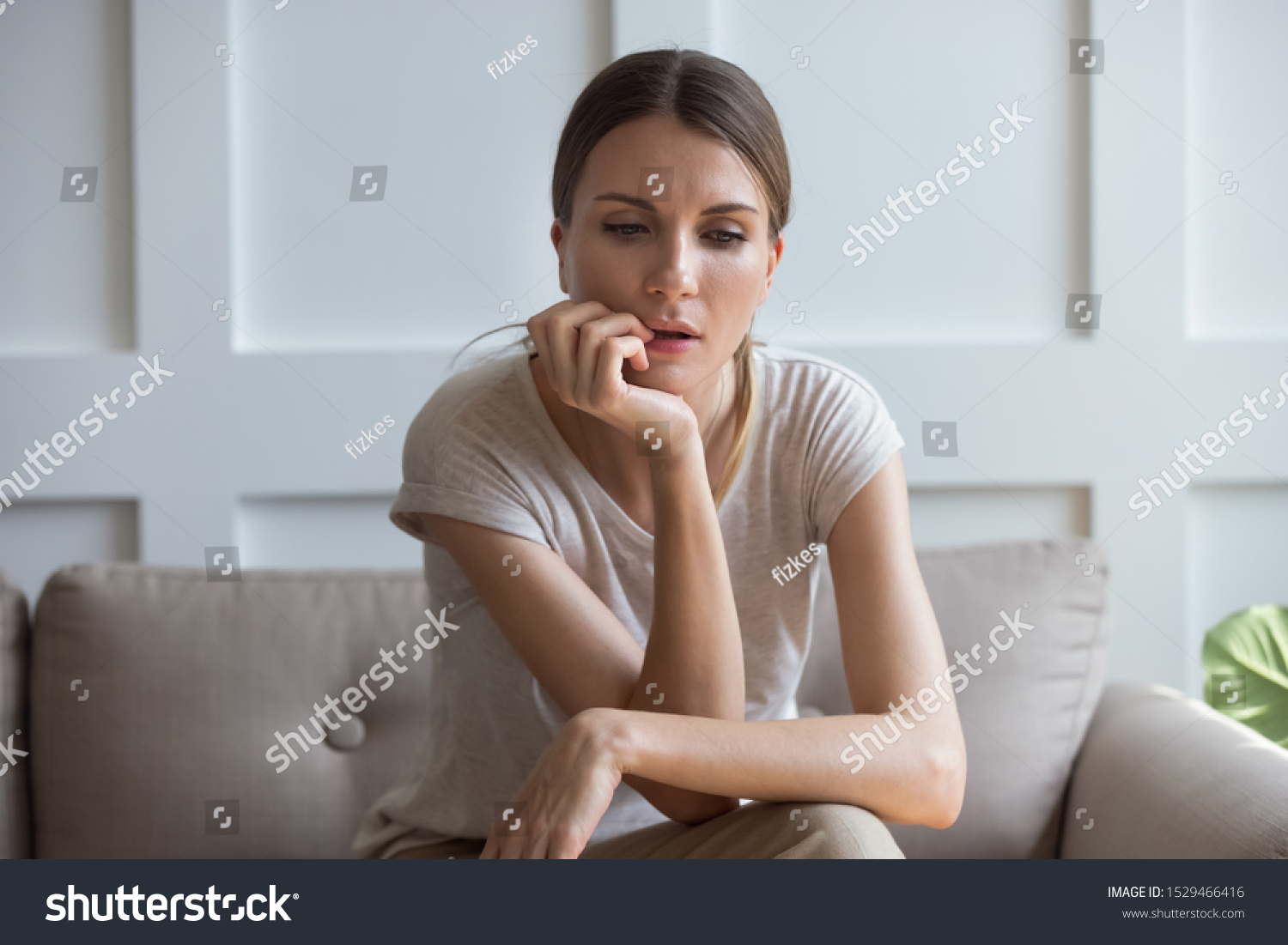Lost on sad thoughts millennial 30s woman sitting on couch at home feels emptiness by personal difficulties and unsolvable problems, concept of jealous wife, lonely single frustrated female concept #1529466416