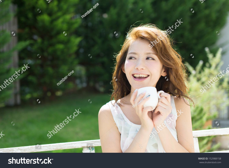 beautiful young woman relaxing outdoor stock photo 152988158   shutterstock