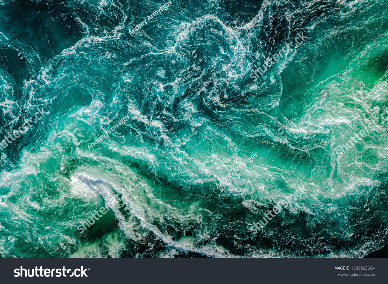 Waves of water of the river and the sea meet each other during high tide and low tide. Whirlpools of the maelstrom of Saltstraumen, Nordland, Norway #1529923664
