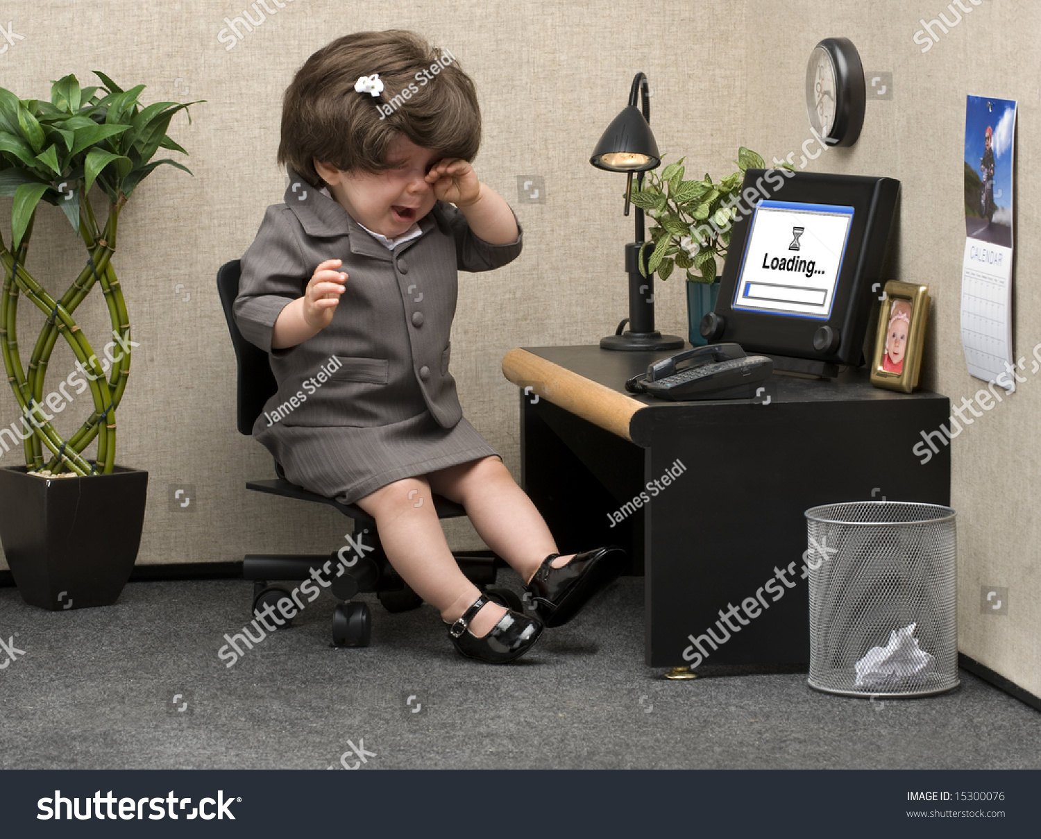 baby dressed professional office attire crying stock photo