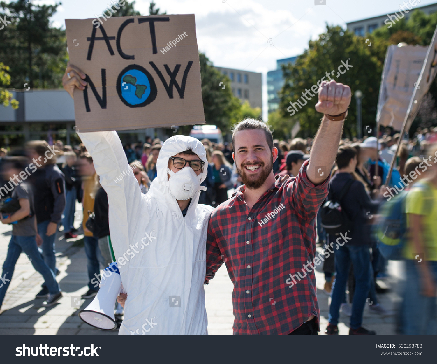 People with placards and protective suit on global strike for climate change. #1530293783
