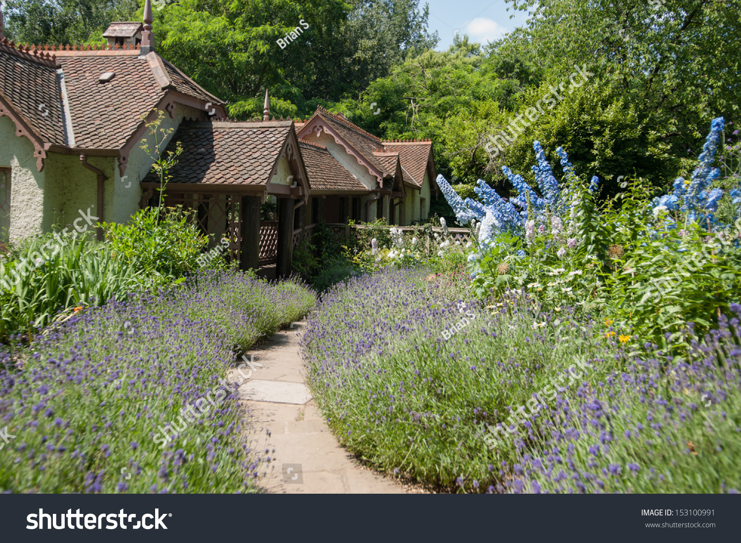 English Cottage And Garden Path Leading To Entrance