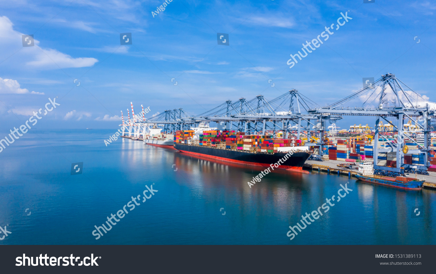 Container cargo ship at industrial port in import export business logistic and transportation, Container ship loading and unloading freight shipment, Aerial view container cargo boat freight ship. #1531389113