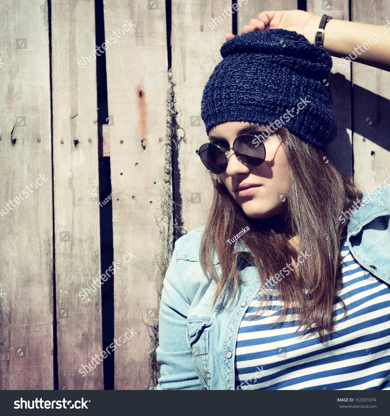 Beautiful Cool Girl In Hat And Sunglasses Against Grunge