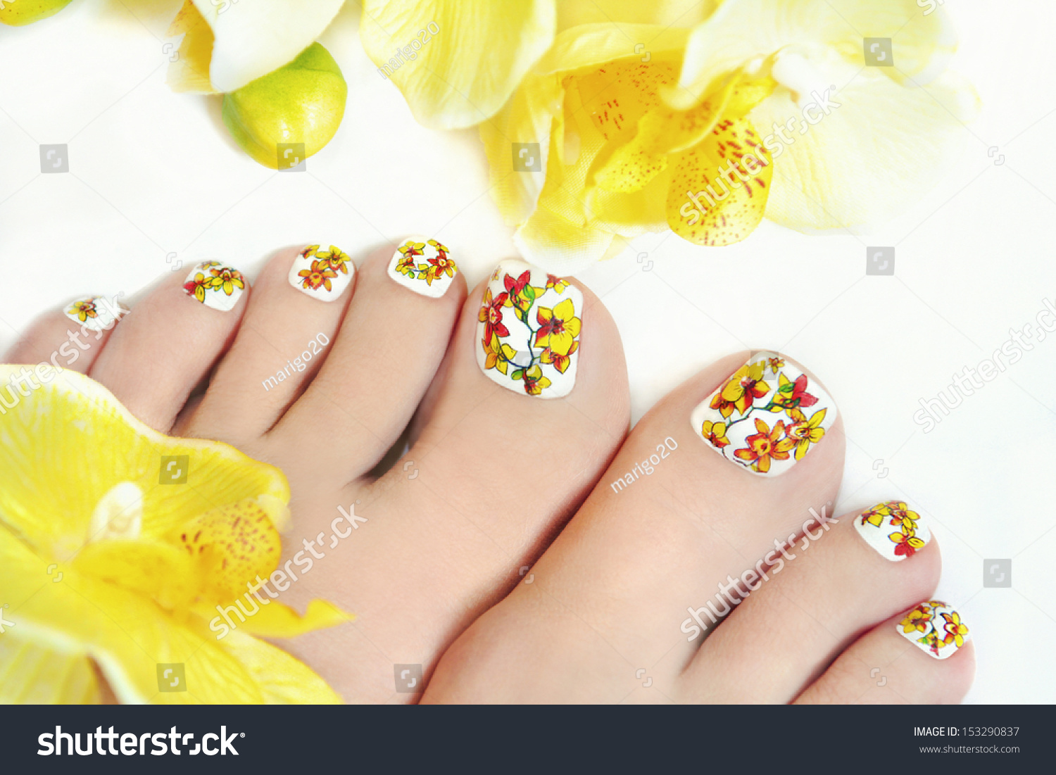 Nail art design on womens legs stock photo 153290837 shutterstock nail art design on womens legs with orchids on a white background prinsesfo Images