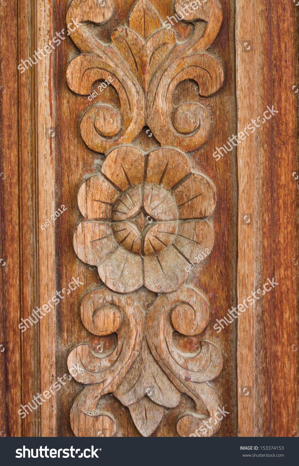 Wood carving flowers leaves stock photo