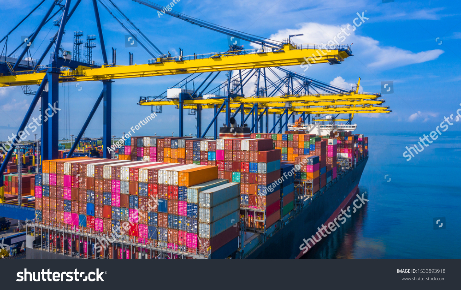 Container cargo ship at industrial port in import export commercial trade business logistic and transportation of international by container cargo ship boat in the open sea, Aerial view industry crane #1533893918