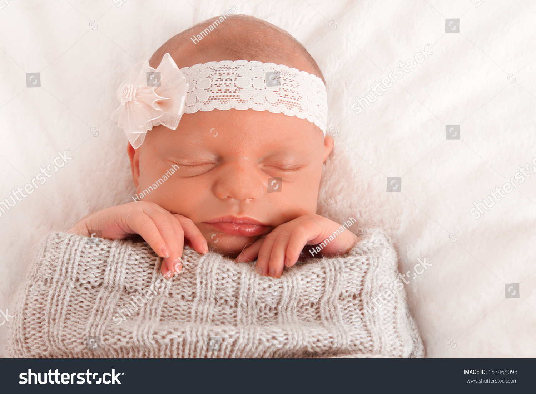 A Newborn Girl Falls Asleep On Her Father Stock Image