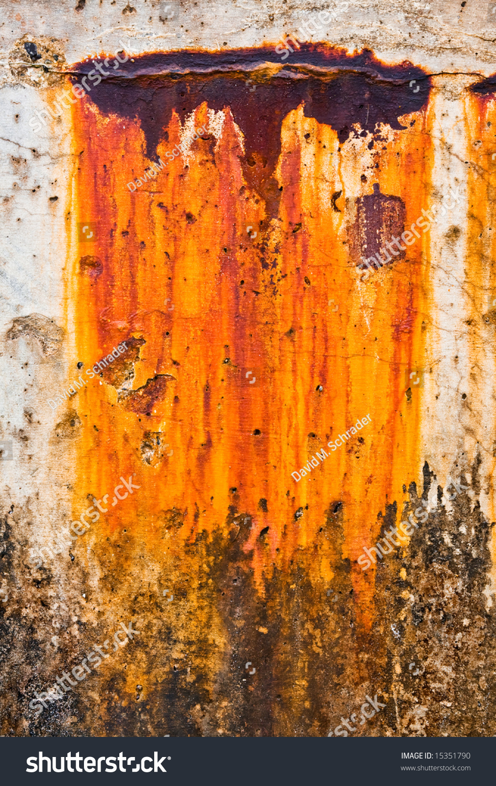 Rust Cement Wall : Colorful rust stain drips along harbor stock photo