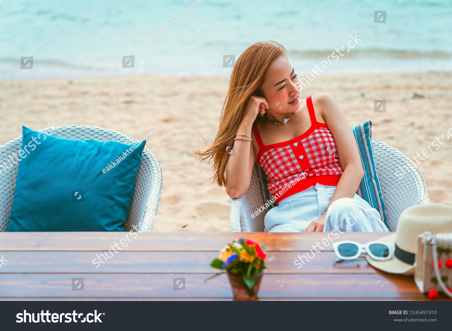 traveler girl in red dress sit on the chair in beach with vacation trip in emotional relax and smile for relax concept #1535491910