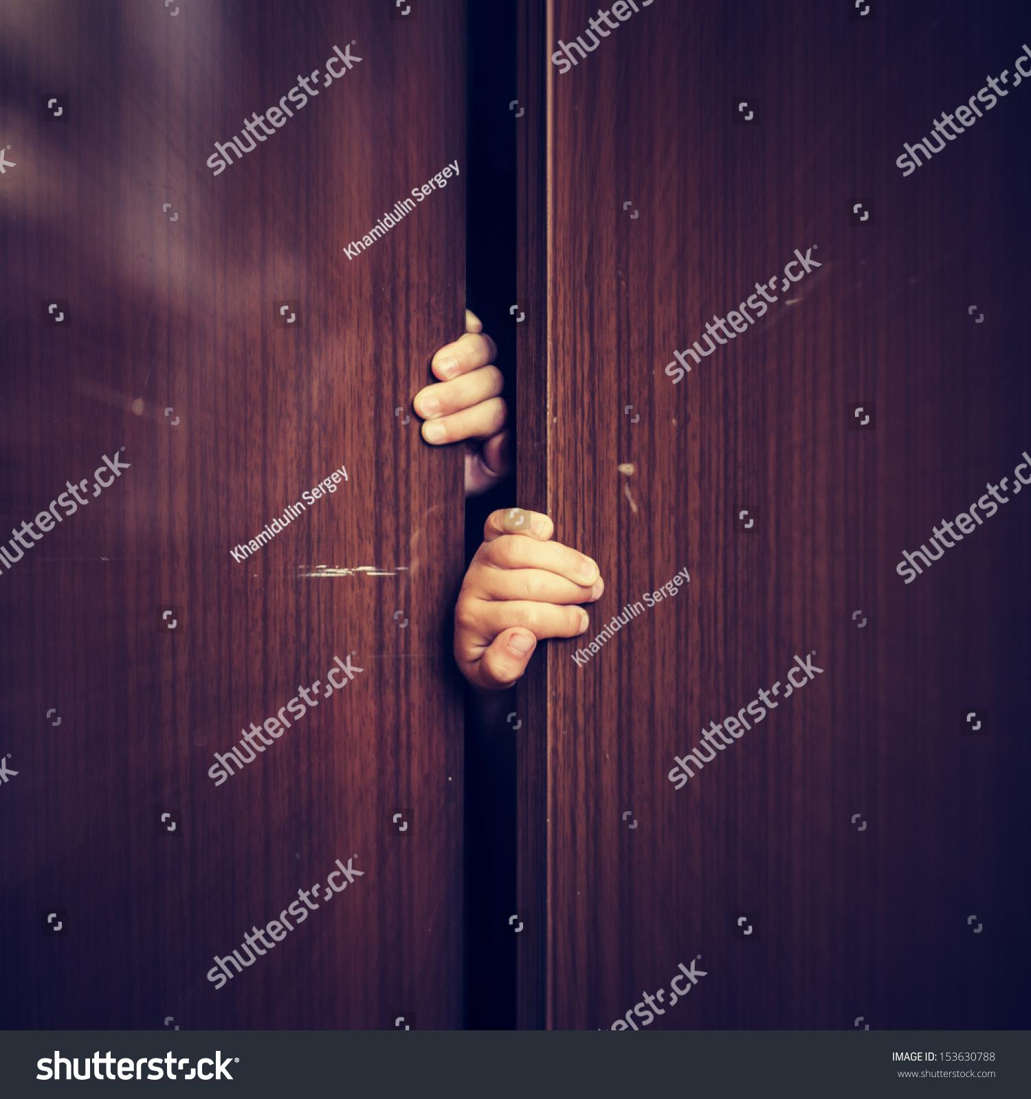 Hiding In The Closet Stock Photos - Image: 31570483