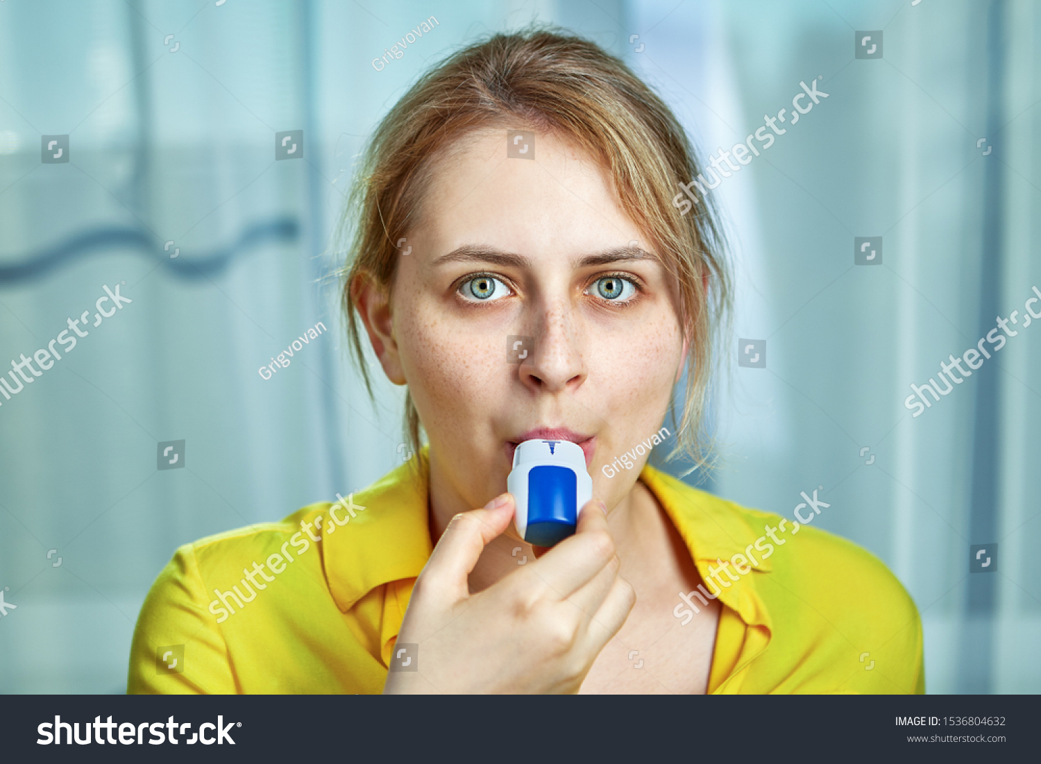 COPD or chronic obstructive pulmonary disease treatment with bronchodilator powder inhaler. A young woman uses dispenser with powders inhalation to relieve symptoms of asthma, and breathing relief.