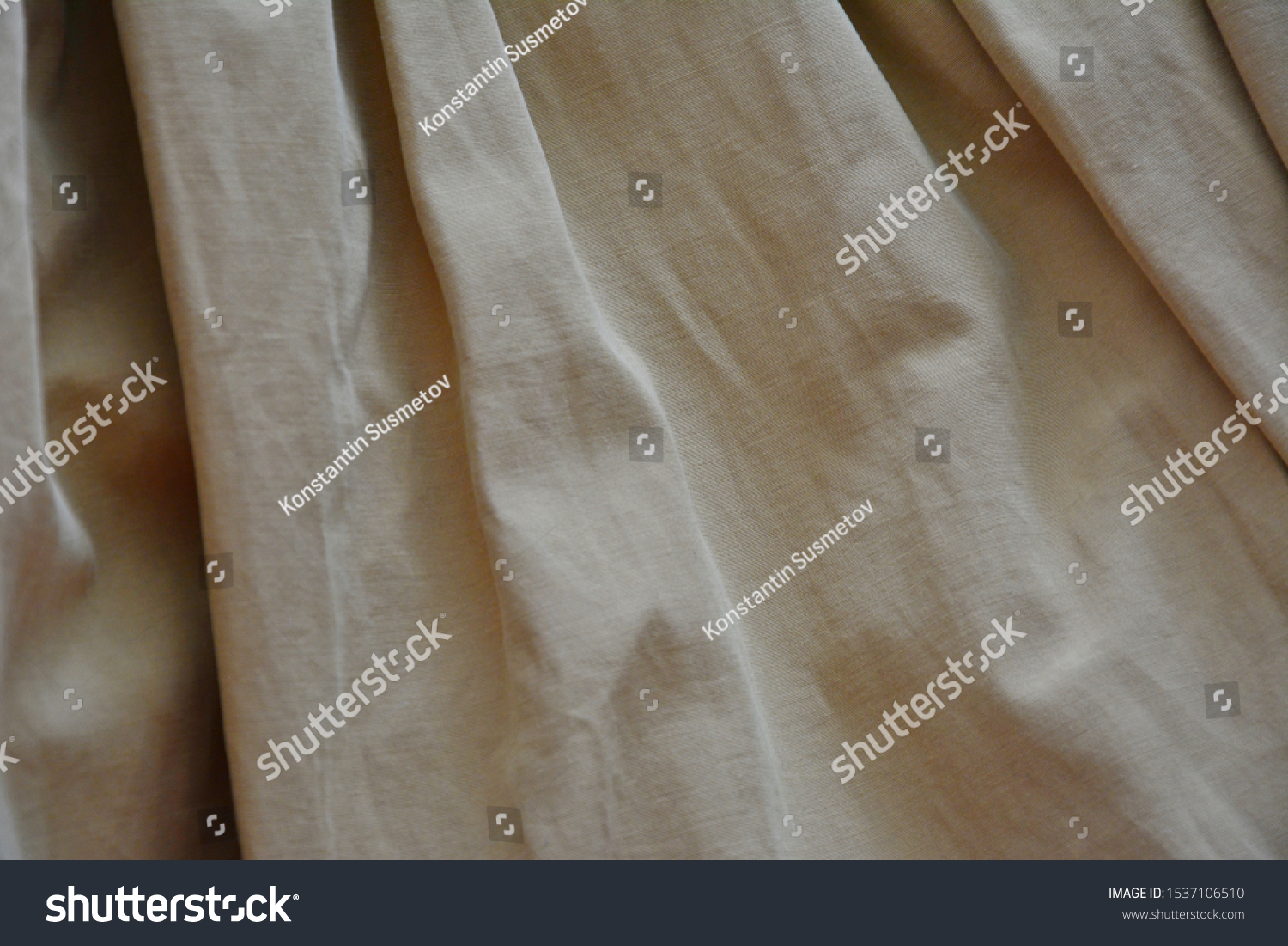Decorative background. Fabric background. Beige fabric. Folds on the fabric. #1537106510