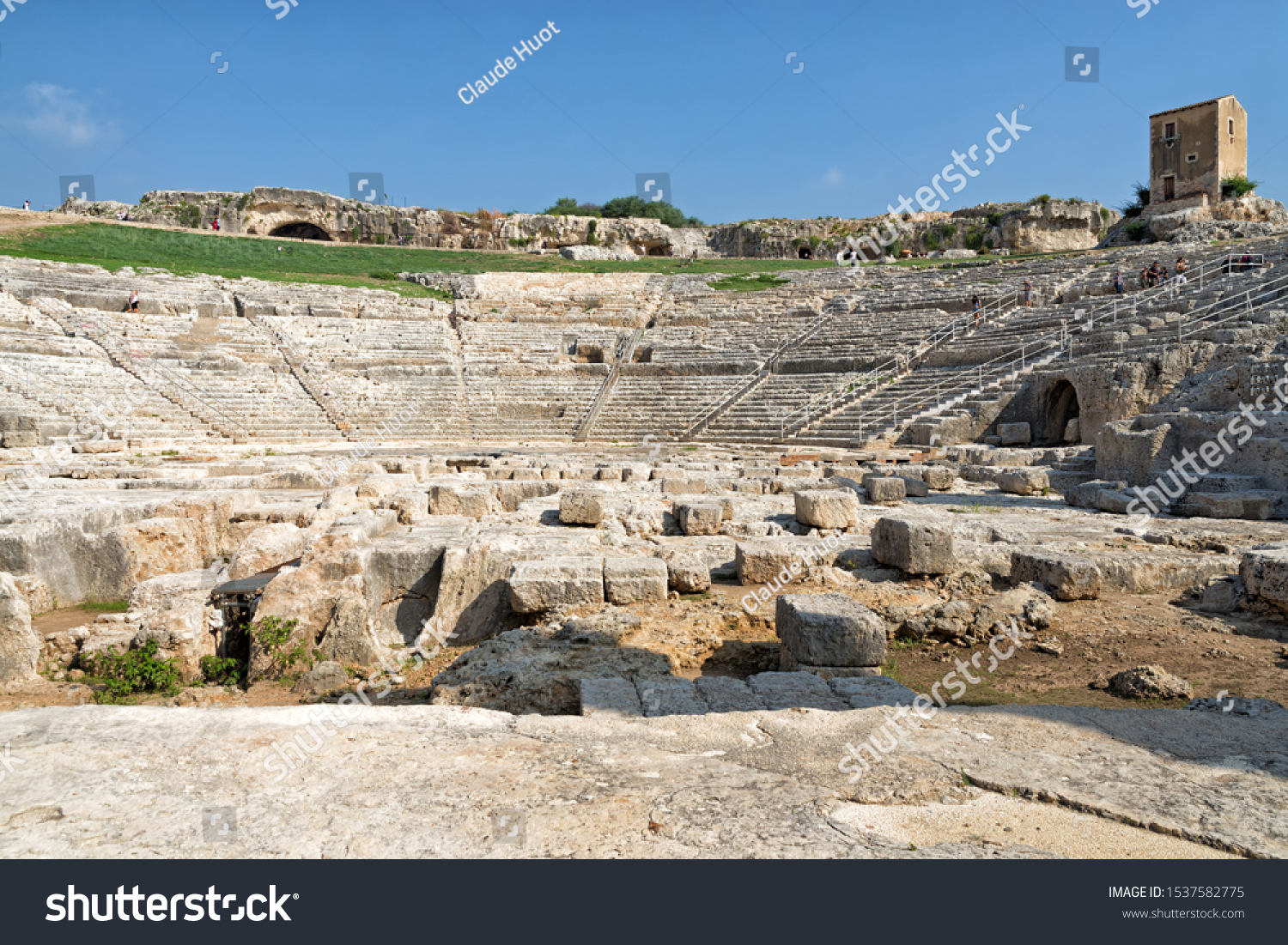 SYRACUSE, SICILY, ITALY - SEPTEMBER 19,2019: The Greek theater of Syracuse on the slopes of the Temenite hill in Sicily, Italy. It was built in the 5th century BC and rebuilt in the 3rd century BC.