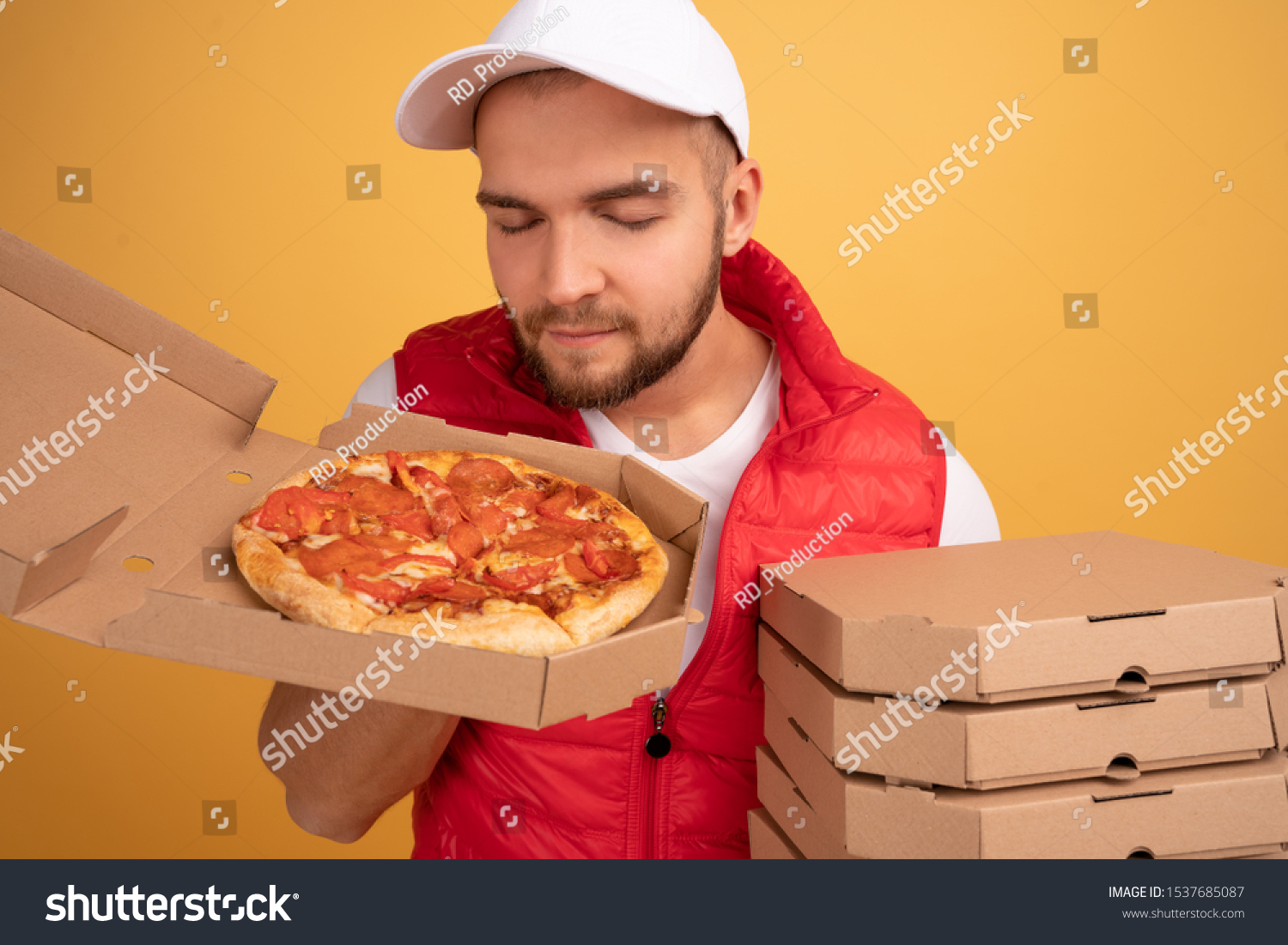 stock-photo-cheerful-pizza-delivery-man-stands-with-carton-boxes-sniffs-delicious-and-fragrant-pizza-wears-1537685087.jpg