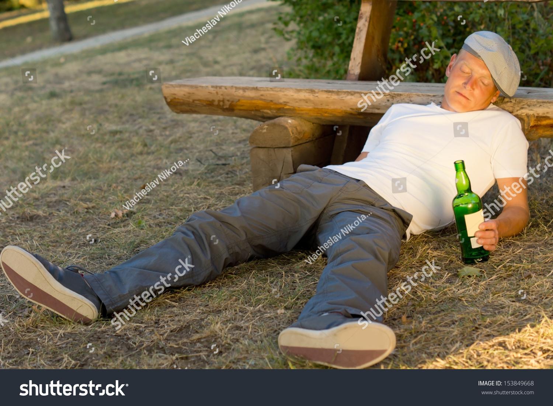 Royalty Free Drunk Man Fallen Asleep On The Ground 153849668 Stock