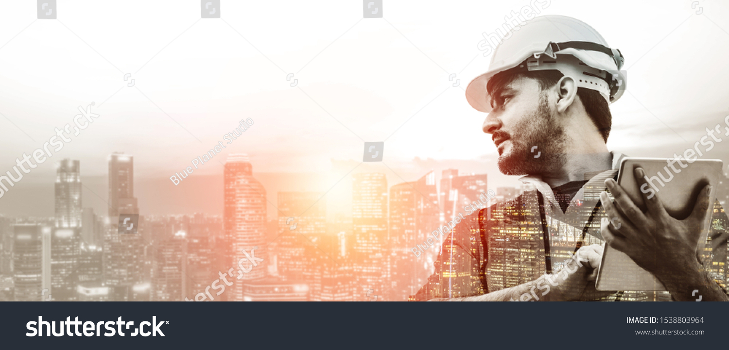 Double exposure image of construction worker with tablet computer and wearing construction uniform against the background of surreal construction site in the city. #1538803964
