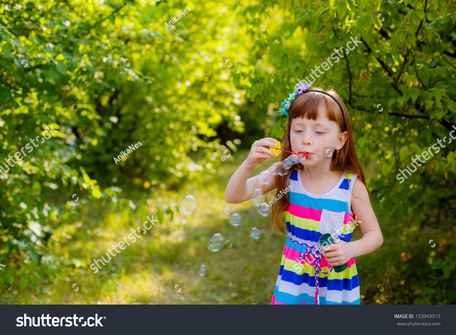 Happy Kids With Soap Bubbles Stock Photo 153943913
