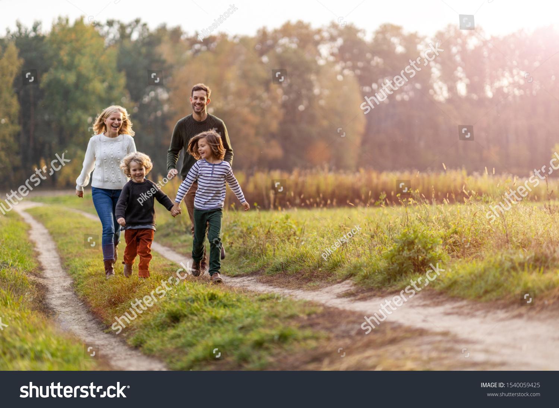 Young family having fun outdoors  #1540059425
