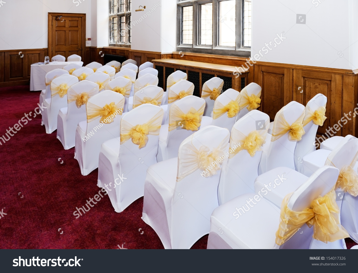 Wedding Ceremony Furniture And Chairs With White Covers And Yellow Ribbon Stock Photo 154017326