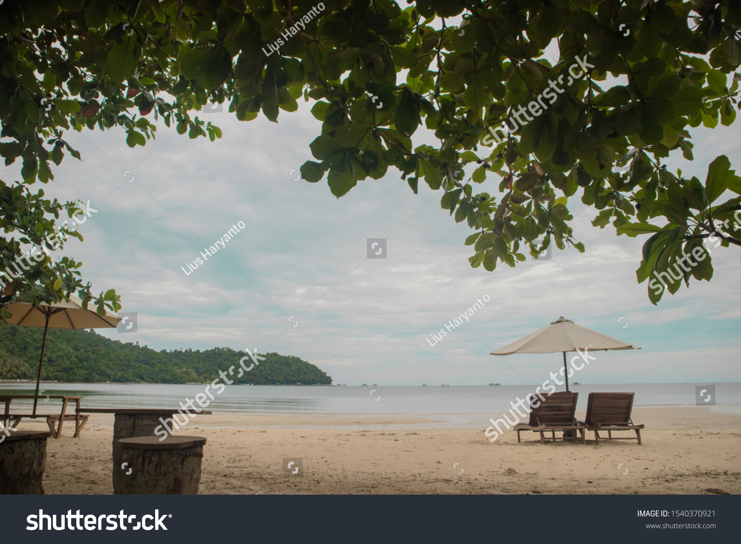 Chairs and umbrella at beautiful beach #1540370921
