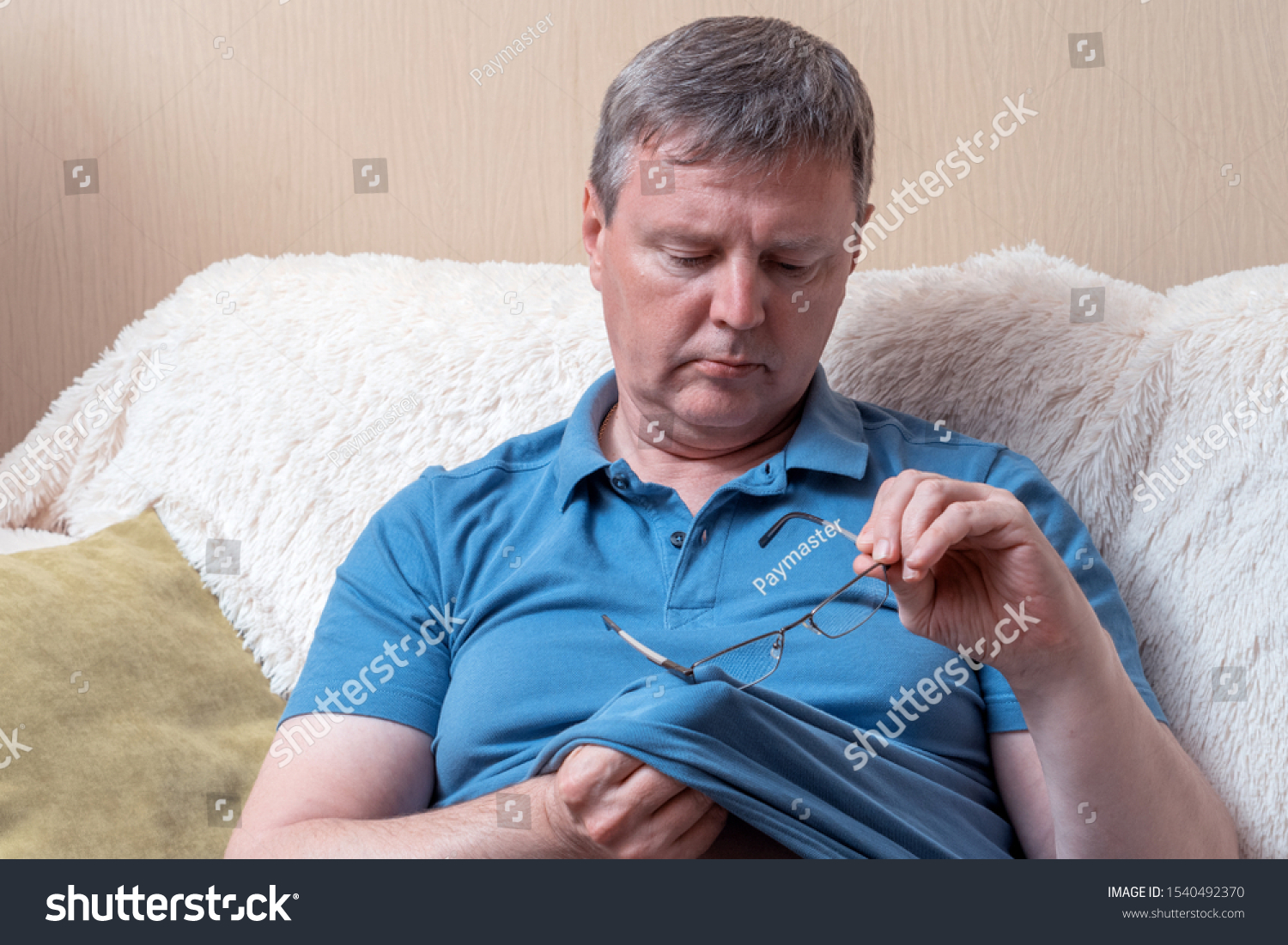 Portrait man cleaning glasses with a t-shirt #1540492370