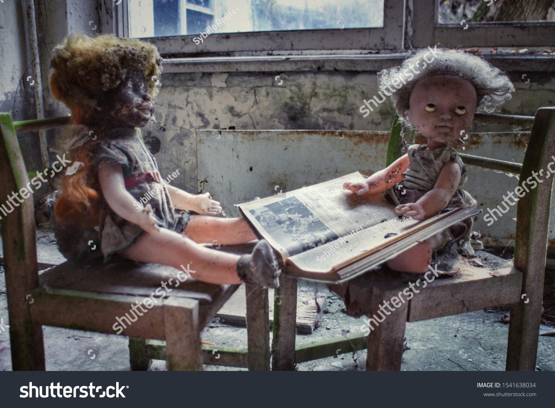 stock-photo-creepy-dolls-on-toy-chairs-w