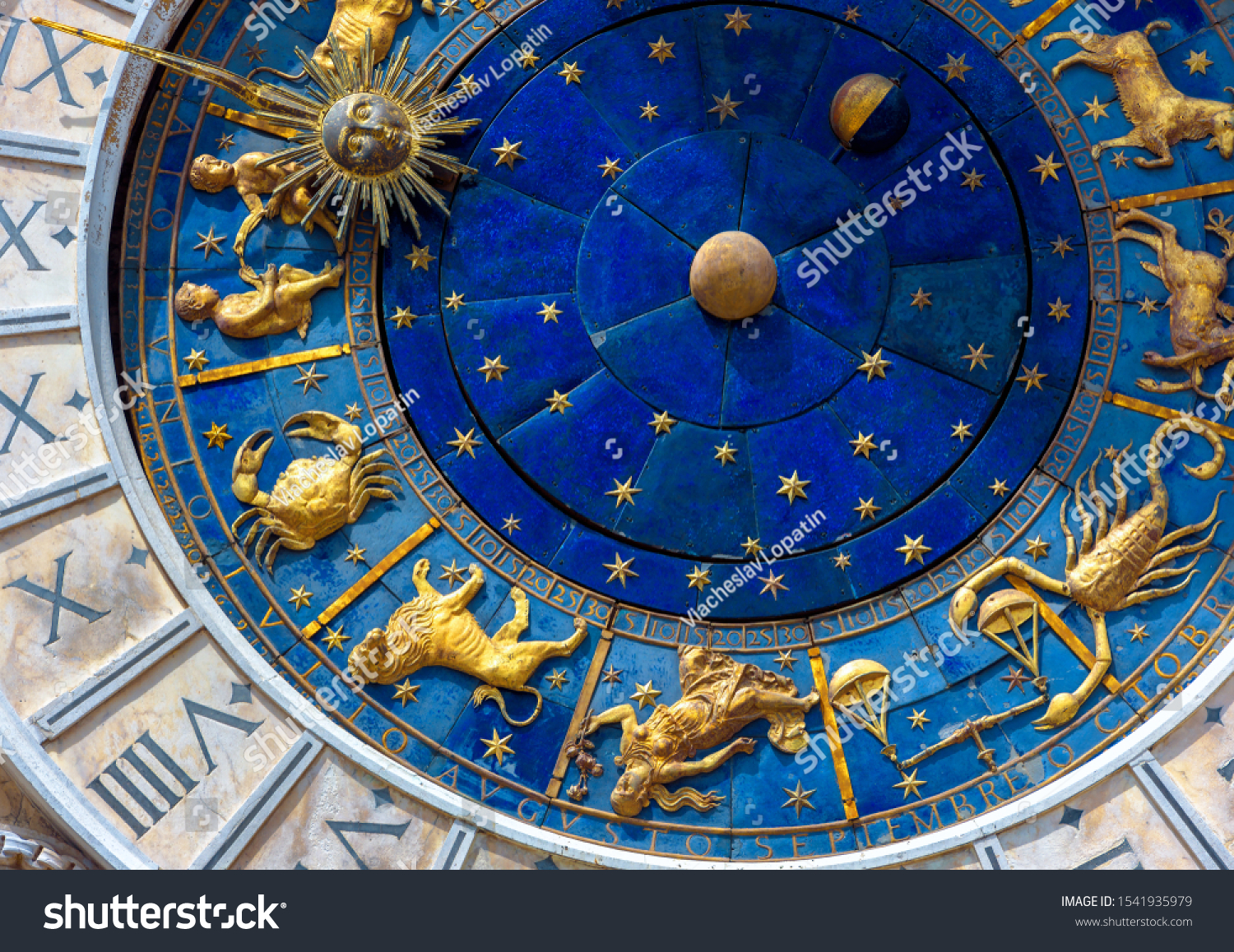 Astrological signs on ancient clock Torre dell'Orologio, Venice, Italy. Medieval Zodiac wheel and constellations. Golden symbols on star circle. Concept of astrology, horoscope and time. #1541935979