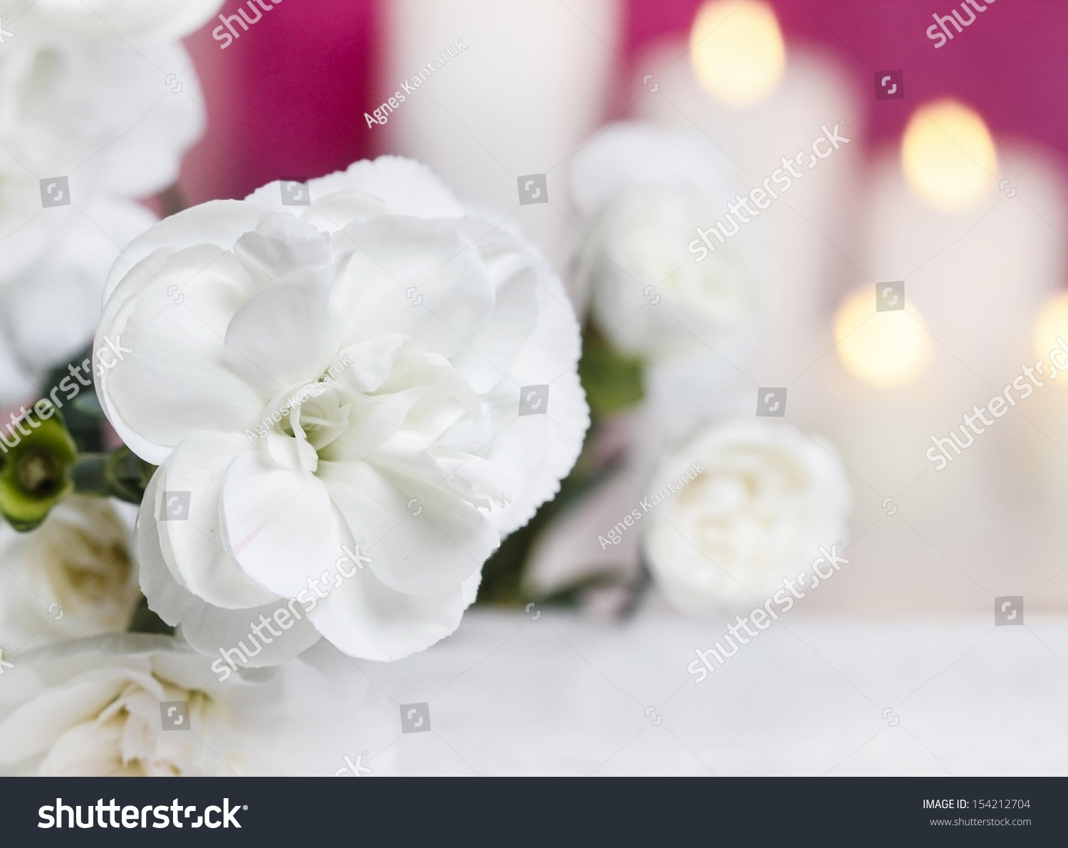 White Carnation Flowers Candles Background Selective Stock Photo