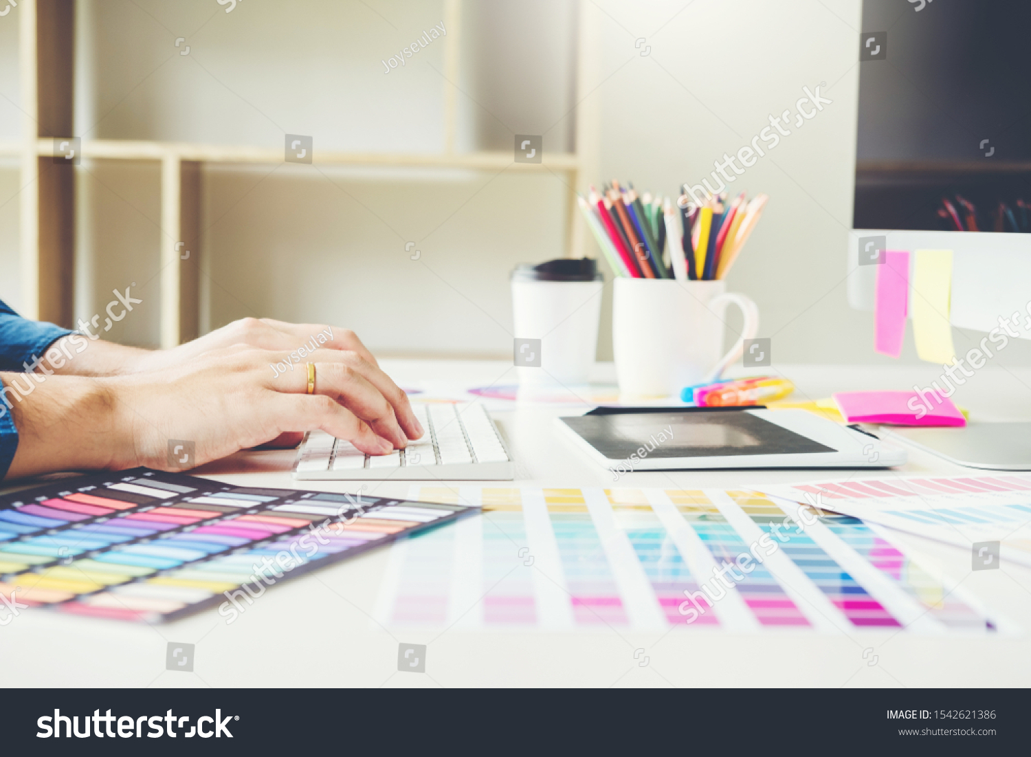 Graphic designer drawing on graphics tablet at workplace #1542621386