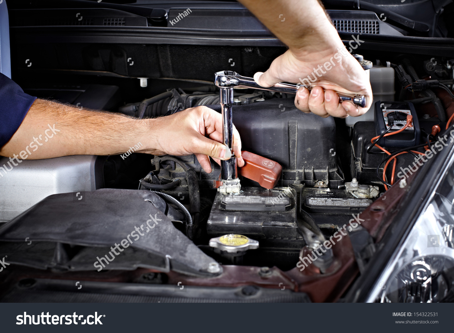 Auto mechanic working garage repair service stock photo for Garage reparation auto