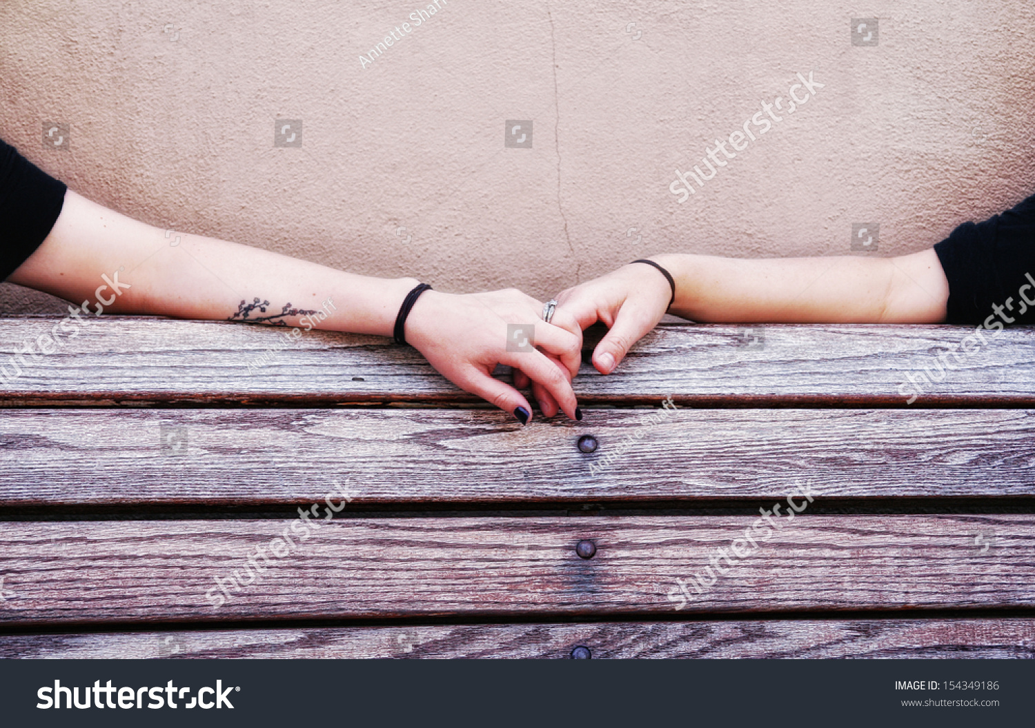 Two People Holding Hands On A Bench Stock Photo 154349186 ...