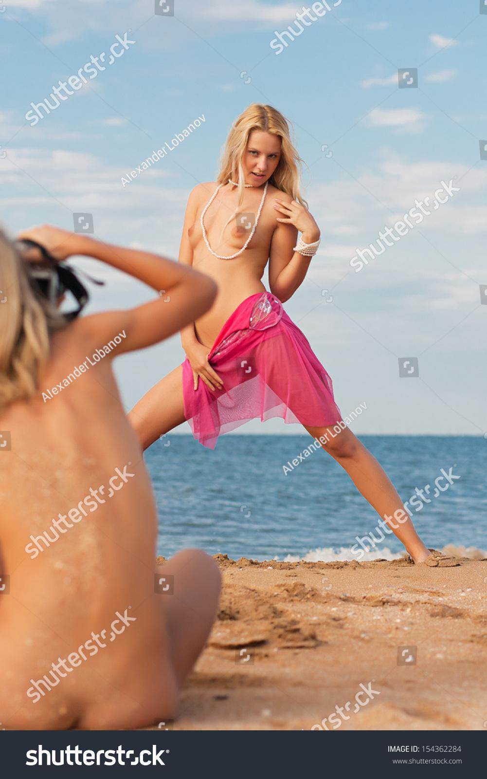 Naked girl posing on the beach nude girl photographer.