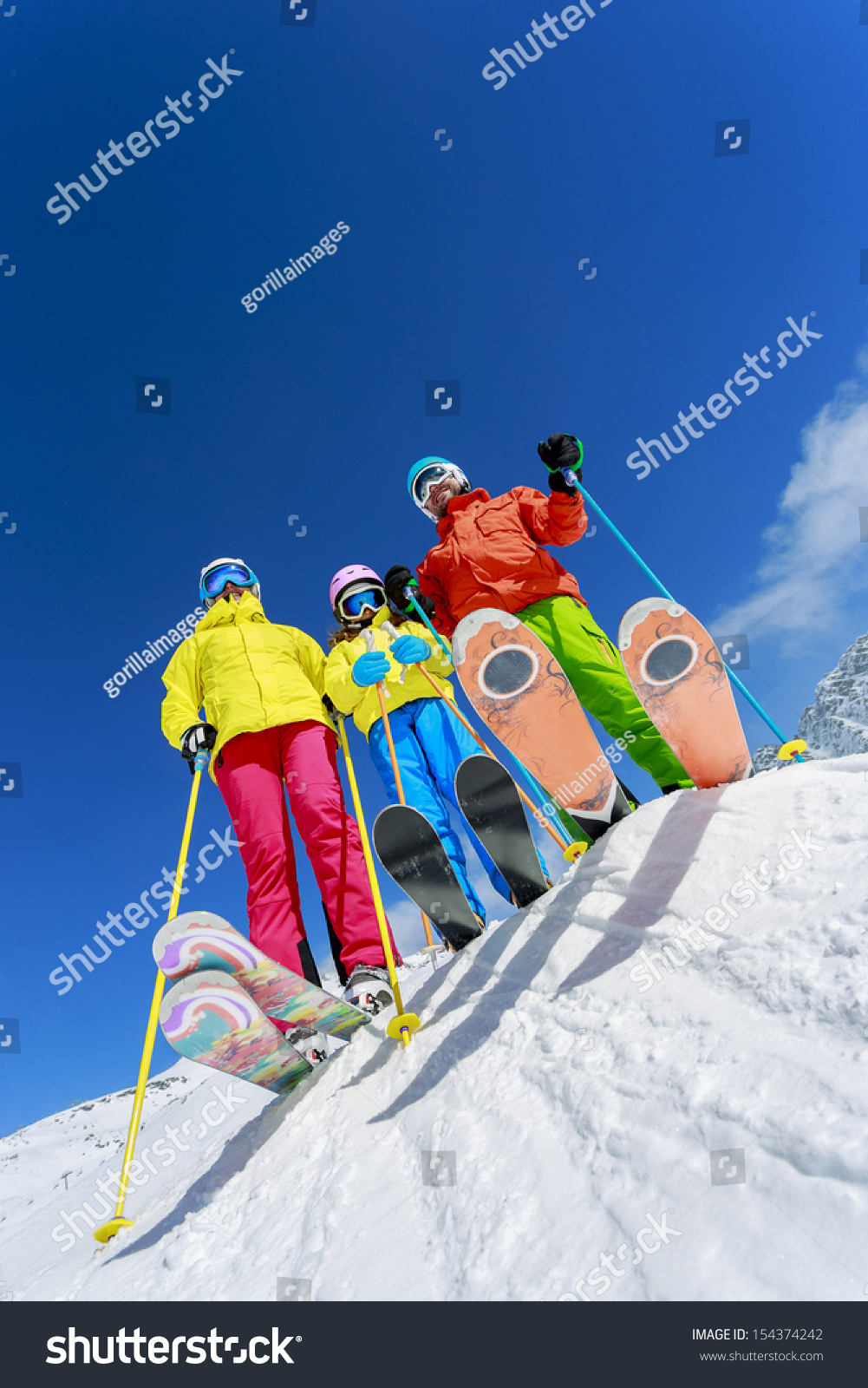 Skiing winter snow skiers sun fun stock photo 154374242 for Vacation in the snow