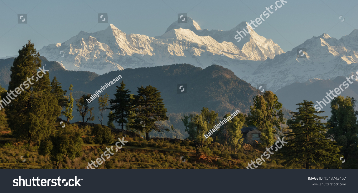 A view of a landscape of scenic Himalayas peaks from a hillside in the village of Chaukori in the state of Uttarakhand in India.