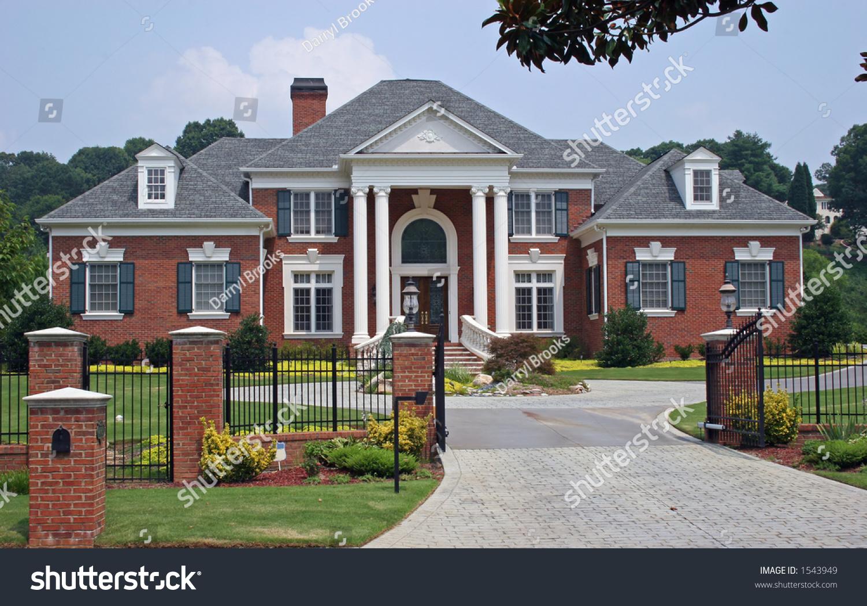 Large Brick House Behind Iron Gate Stock Photo 1543949