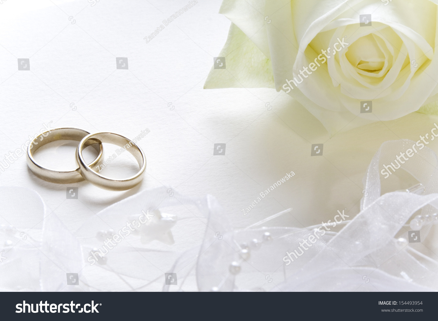 Wedding Background With Bands And White Rose: Cross Backround Wedding Bands At Websimilar.org