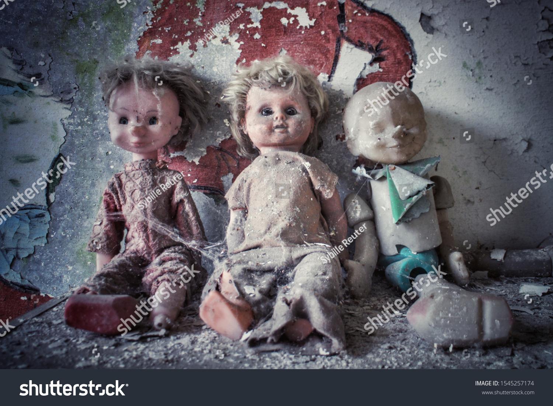 stock-photo-three-creepy-dolls-sitting-i